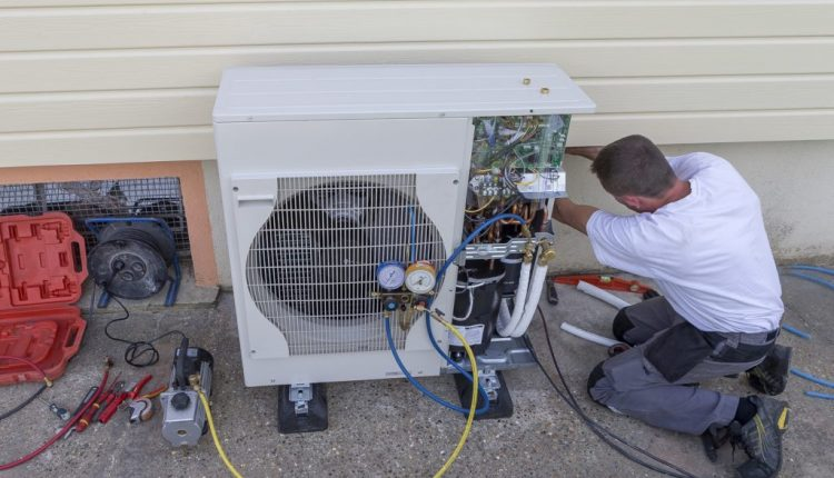 heat Pump. plumber at work installing a circulation pump